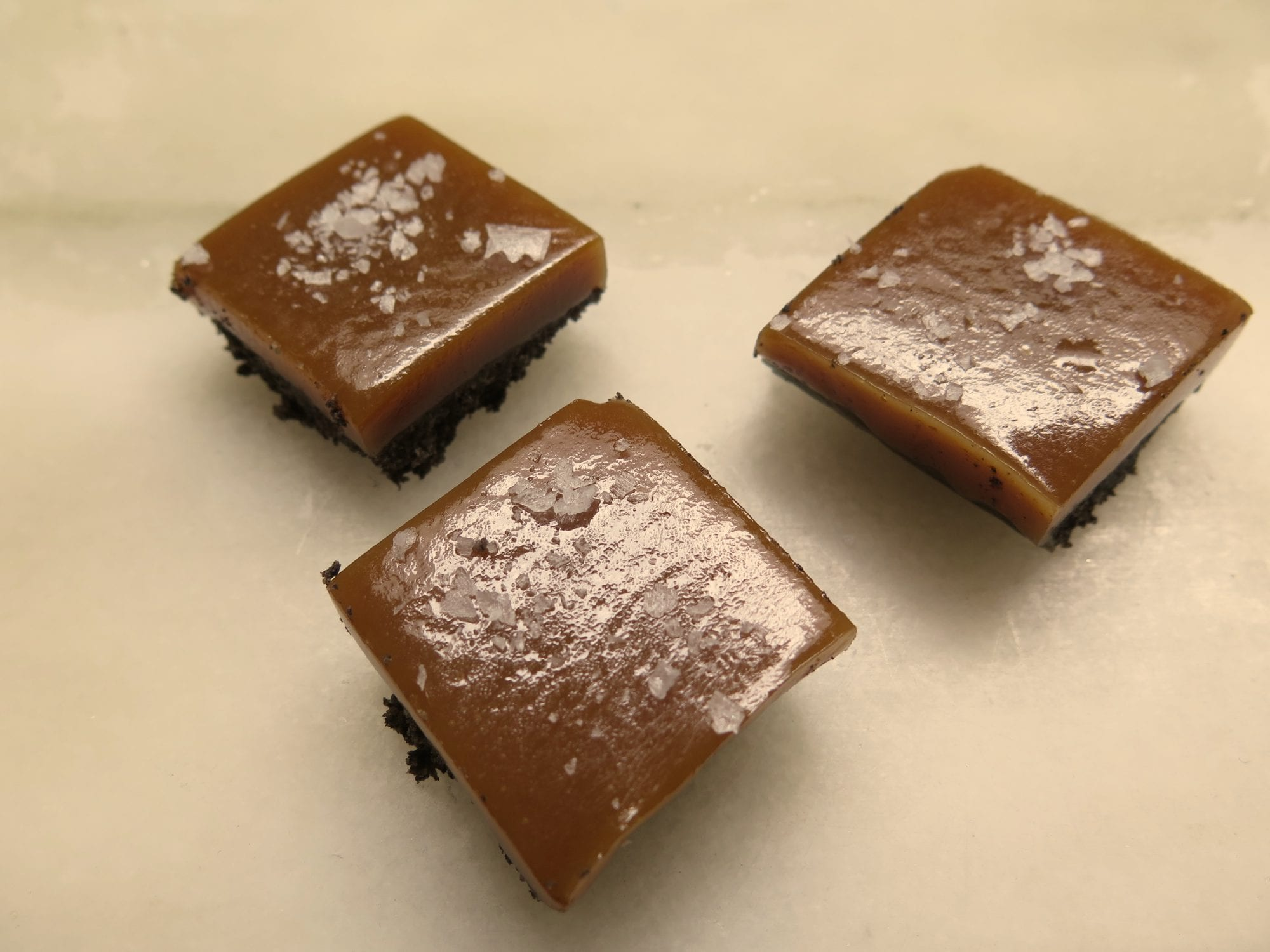 salty caramel bars with a black cocoa (saltine) crust and sea salt